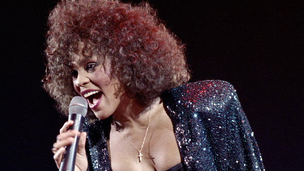 """Whitney Houston performs in 1988. The new Showtime documentary, <em>Whitney. """"Can I Be Me,""""</em> includes footage of her world tour in 1999."""