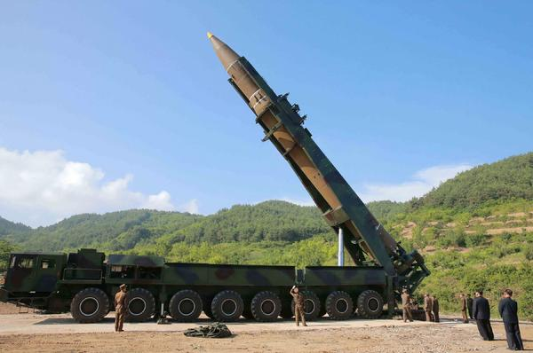 This picture taken and released on July 4, 2017 by North Korea's official Korean Central News Agency (KCNA) shows North Korean leader Kim Jong Un inspecting the test-fire of the intercontinental ballistic missile Hwasong-14 at an undisclosed location. (STR/AFP/Getty Images)