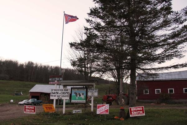 A flag flies over a home in Delaware County, N.Y.