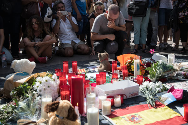 Tributes have been left on Las Ramblas boulevard near the scene of Thursday's terrorist attack in Barcelona, Spain. Fourteen people were killed and dozens injured when a van plowed into pedestrians.