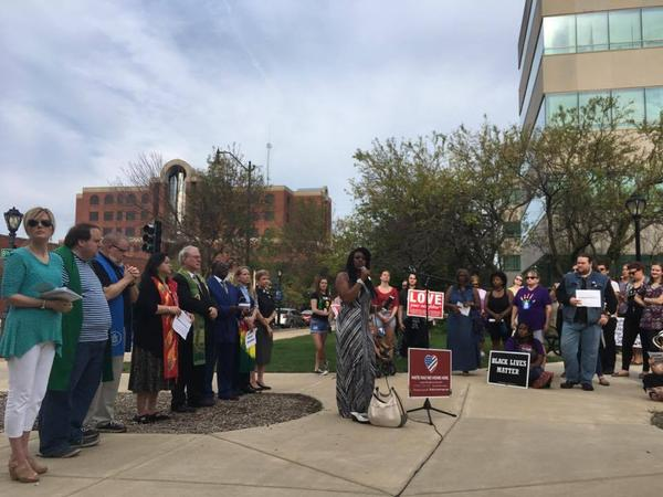 Theresa Haley of NAACP's Illinois addresses a vigil in Springfield