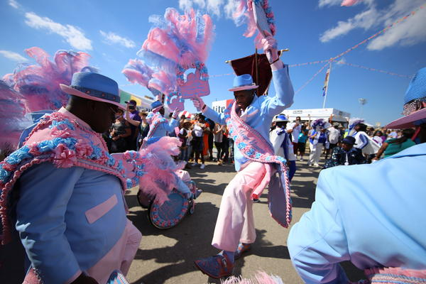 A second-line parade featuring the Original Pigeon Town Steppers at the 2017 New Orleans Jazz and Heritage Festival, one of many sights underlining the event's place-based identity.
