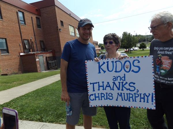U.S. Sen. Chris Murphy is greeted by some supporters at the Danbury War Memorial on Thursday at the end of his five-day, 100-mile walk across Connecticut.