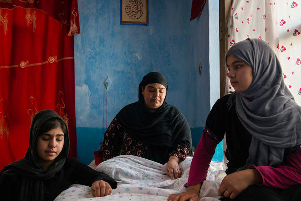 Mina, 38, was pregnant with her fifth child when she was diagnosed with spinal tuberculosis. She became paralyzed from the waist down at the time she gave birth. The child didn't survive. Her husband kicked her and her children out of the house and remarried. Mina, who is now living in Kabul, Afghanistan, survived several suicide attempts.