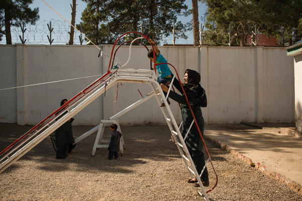 Inside the prison in Herat, there is a kindergarten and a small playground for the kids. There are currently 57 children living with their mothers inside the female ward. These mothers are often abandoned or disowned by their families for the crimes they may or may not have committed.