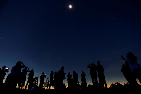 People watch the total solar eclipse from Clingmans Dome, in the Great Smoky Mountains National Park in Tennessee.