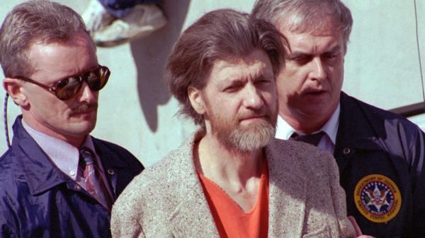 Ted Kaczynski is flanked by federal agents as he is led from the federal courthouse in Helena, Mont., on April 4, 1996. Kaczynski is now serving a life sentence in prison for the bombings.
