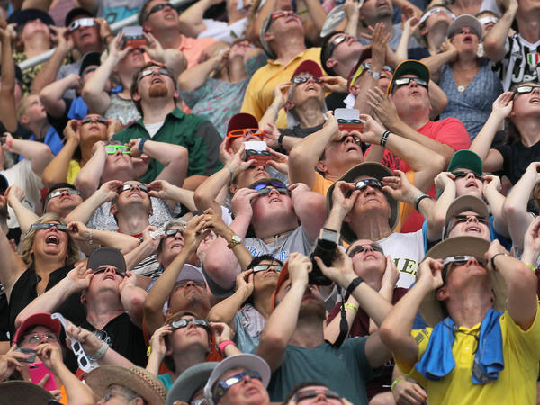 Crowds gathered to watch the solar eclipse at Saluki Stadium on the campus of Southern Illinois University in Carbondale, Ill.