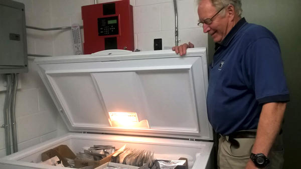 "New England Wildflower Society's Bill Brumback, opening the freezer that acts as the ""seed vault,"" in Framingham, Mass."