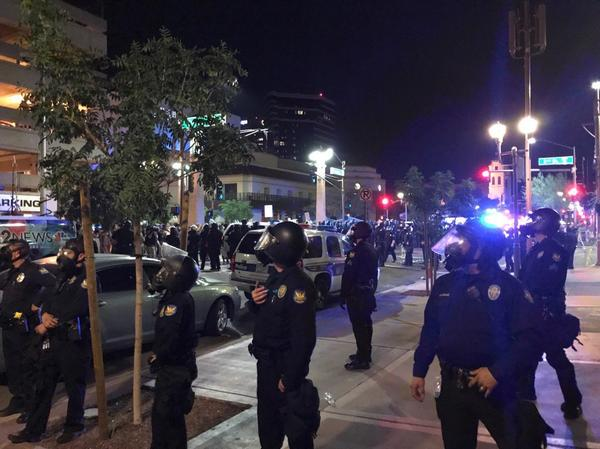 Phoenix police order protesters outside the venue where President Trump held a rally Tuesday to disperse. Officers used tear gas to try to force the crowd to leave.