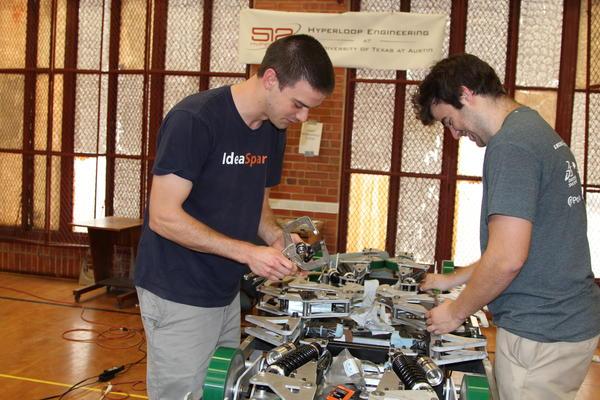 512 Hyperloop team members John Sigmund and Eric Simmons work on their pod prototype.