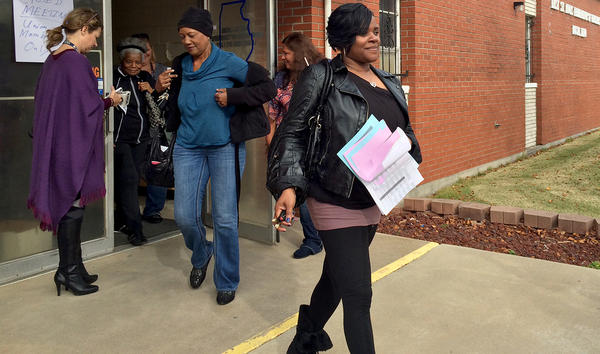 East St. Louis teachers walk out of their union hall after voting to approve a tentative contract agreement in 2015. A new report says Illinois' teacher pension fund exacerbates gaps in per-pupil funding among districts.