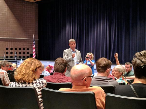 Bill Huizenga answering a question during a public town hall meeting