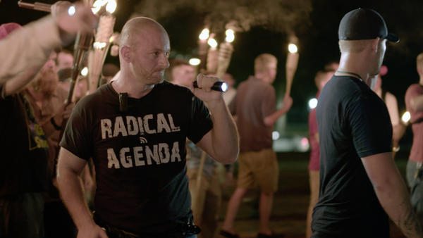 Christopher Cantwell seen in a <em>VICE News Tonight</em> video of the Aug. 11 white nationalist march in Charlottesville, Va. On Wednesday, Cantwell turned himself in to police to face three felony charges.