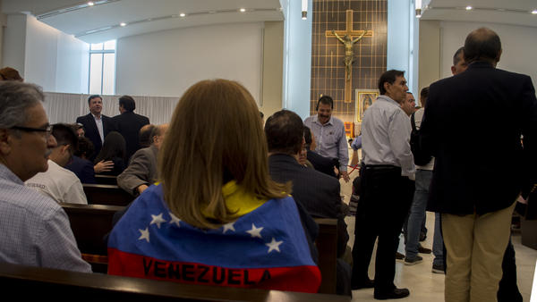 Morella Aguerrevere wore Venezuela's flag over her shoulders, waiting for the conference to begin.