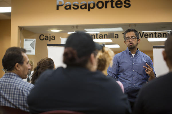 Candelario Vazquez teaches people waiting for visas and passports at the Mexican Counsulate about their rights.