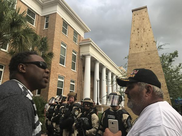 Two disabled veterans discussing what should be done with the statue.