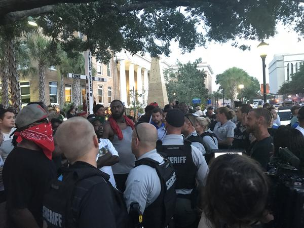 After the official protesters marched away back to Twin Dolphin Marina, others stayed in a stand-off with counter protesters. Law enforcement horses eventually broke up the stand-off.