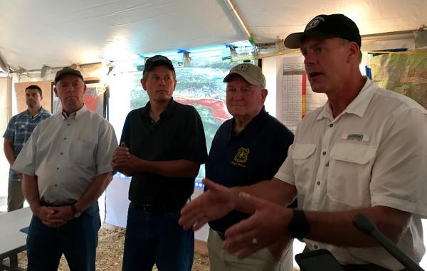 From left to right, Rep. Greg Gianforte, Sen. Steve Daines, Ag Secretary Sonny Perdue, Interior Secretary Ryan Zinke during a visit to the Lolo Peak Fire operations center August 24, 2017.
