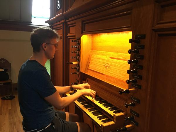 Organist Joseph Ripka at the instrument at Calvary Church.