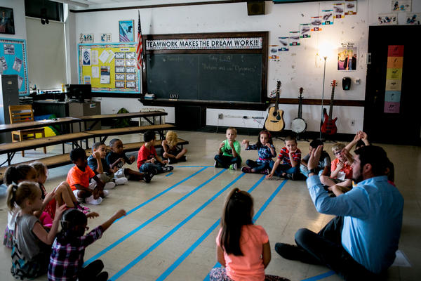 Liam Rusmisel (green shirt) in a music class at Madison Elementary School