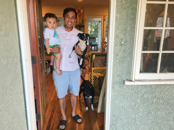 Nguyen Tran and his son Cillían, together with their two dogs Oreo and LeBeouf.