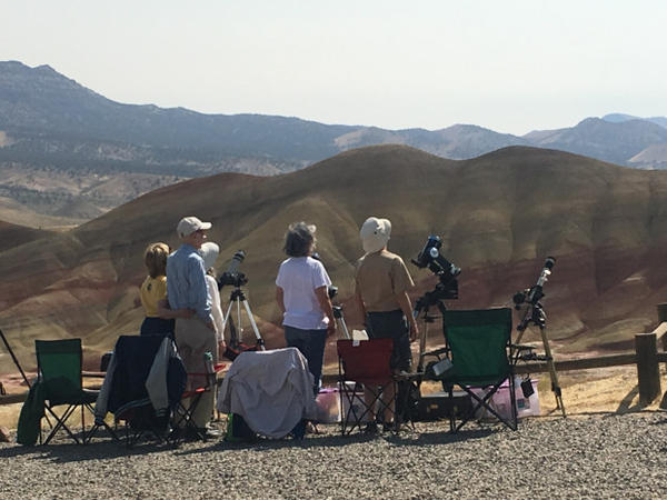 <p>Visitors watch and photograph the eclipse in Oregon's Painted Hills.</p>