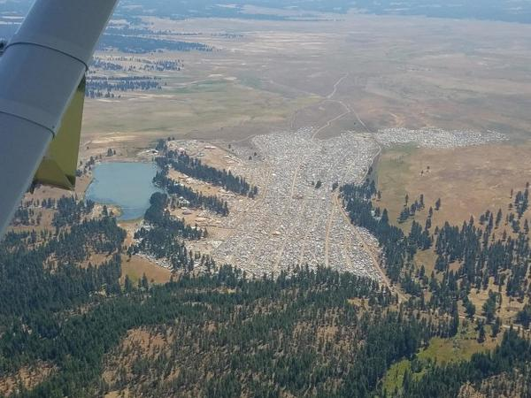 <p>An aerial photo of the Symbiosis Festival on private land in the middle of the Ochoco National Forest.</p>