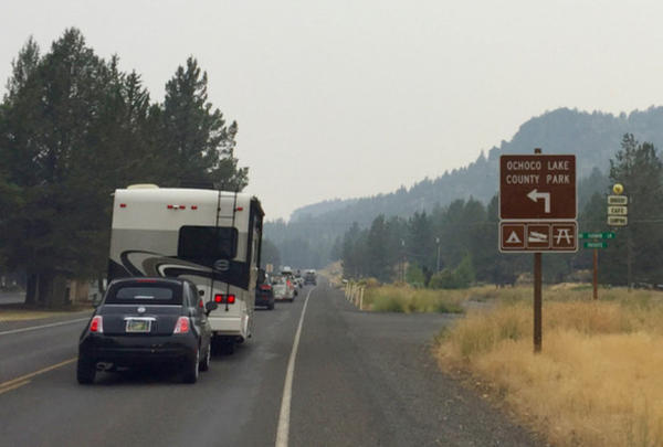 <p>A line of traffic from the Symbiosis Festival files out of the Ochoco National Forest near Prineville.</p>