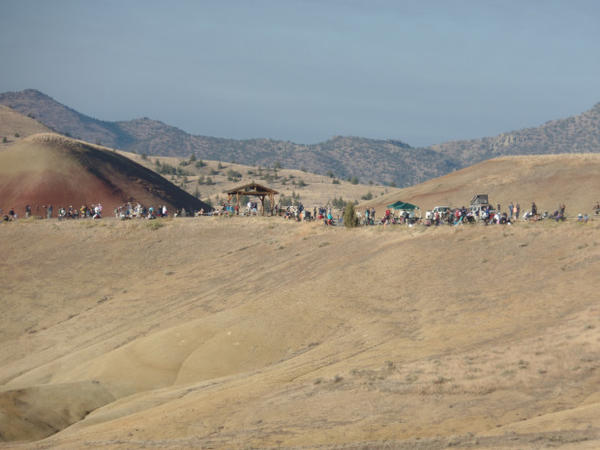 <p>Visitors line up to watch the eclipse in Oregon's Painted Hills National Monument.</p>
