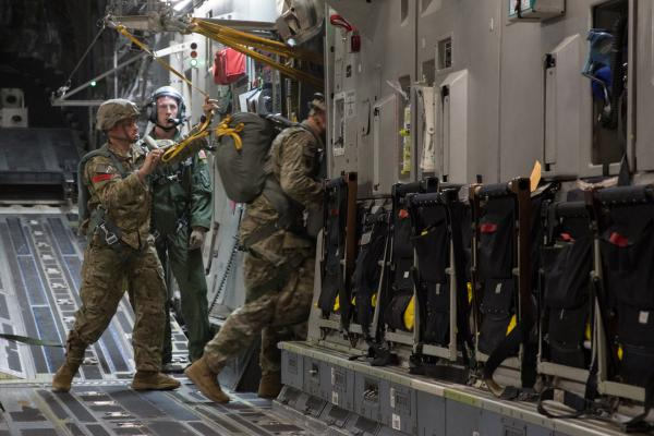 Paratroopers from the 82nd Airborne Division jump from a C-17 aircraft during a July training exercise at Fort Bragg.