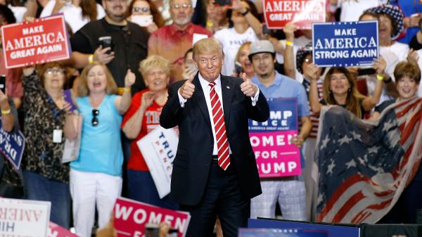 President Trump gives two thumbs-up to a crowd of supporters at the Phoenix Convention Center during a rally this week.