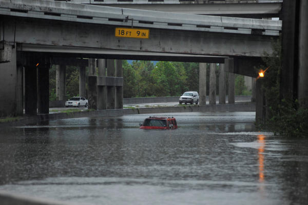 An abandoned Hummer is covered in floodwaters on Interstate 610 after now-Tropical Storm Harvey hit Houston.