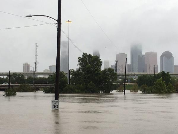 Streets are flooded early Sunday in Houston.