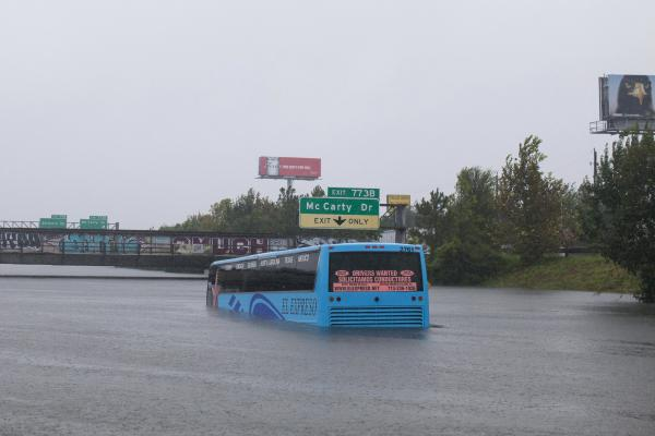 A bus is stuck in the flooded Interstate 10 in Houston on Monday. Hurricane Harvey, a Category 4 storm, made landfall on the Texas coast near Corpus Christi on Friday.