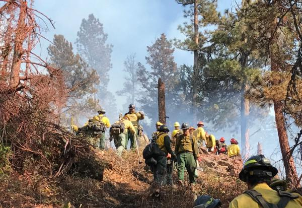 Firefighters from the Oklahoma and Mission Valley inital attack crews construct fire line on the north side of the Blue Bay Fire.