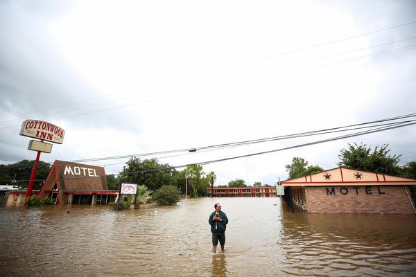Jay Jajal, owner of the Cottonwood Inn in La Grange, surveys the flooding damage to his motel on Monday.