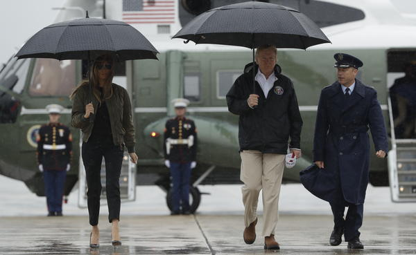 President Trump and first lady Melania Trump walk Tuesday from Marine One to board Air Force One at Andrews Air Force Base for a trip to Texas to get an update on Hurricane Harvey relief efforts.