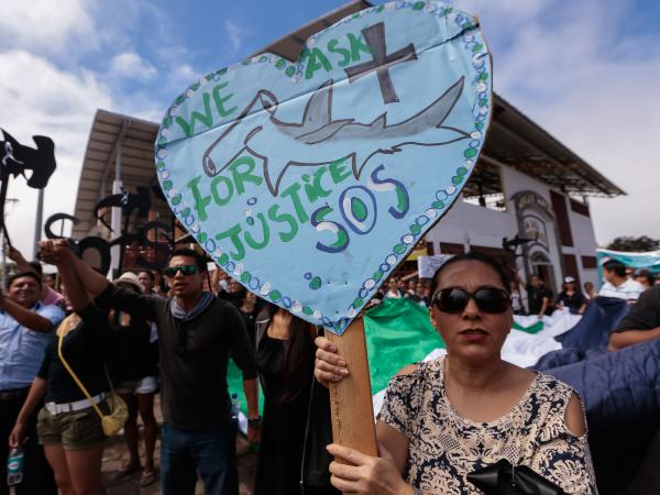 Residents of the Galápagos Islands demonstrate outside the court where the crew of the Chinese-flagged ship had a hearing last week. The Ecuadorean navy earlier this month seized the ship, which had been carrying some 300 tons of fish, including several endangered species such as the hammerhead shark.