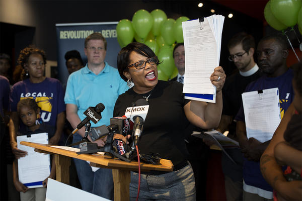 State Sen. Jamilah Nasheed, D-St. Louis, holds up a petition at a rally at Urban Chestnut Brewing Company on Monday. Raise Up Missouri is gathering signatures to put a statewide $12 an hour initiative on the ballot.