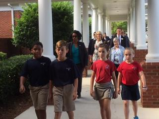 Students lead Education Secretary Betsy DeVos across the campus of Holy Comforter Episcopal School.