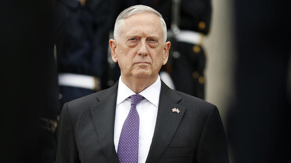 Defense Secretary Jim Mattis will maintain current policy on transgender service members, promising to convene a panel to study how to implement President Trump's ban on transgender troops.