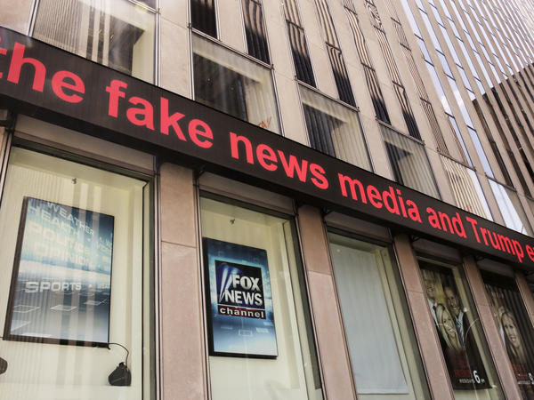 Fox News ceased broadcasting in the UK on Tuesday. Its parent company, 21st Century Fox, is trying to get government approval for its takeover bid of European media giant Sky. Above, headlines scroll across the Fox News studios in New York earlier this month.