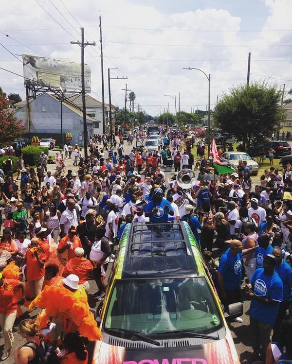People march in a previous second line to commemorate Hurricane Katrina. Tropical Storm Harvey forced event organizers to postpone this year's event.
