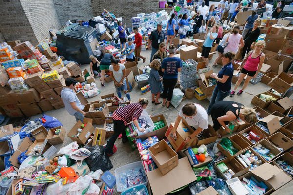 Donated items sit in a loading dock as volunteers works to organize the items donated for Hurricane Harvey victims on Tuesday in Dallas, Texas. This storm has also shown the resilience of Texans- thousands of volunteers have been working to help storm victims.