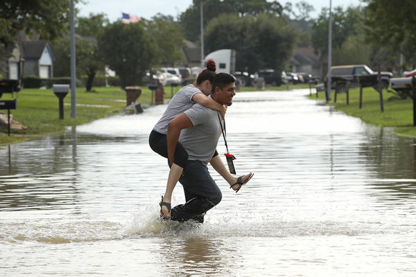 Residents begin to return to their homes in north Houston as flood waters began to recede.