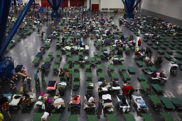 Evacuees fill up cots at the George Brown Convention Center on Aug. 28 in Houston.