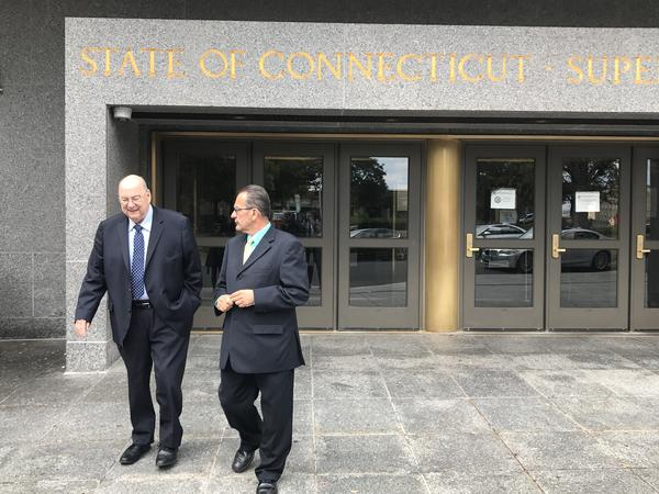 Former Hartford Mayor Eddie Perez, right, leaves criminal court Thursday after pleading guilty to two felony charges. He was joined by his attorney Hubert Santos.