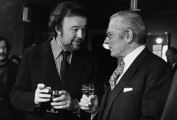 Peter Hall (left) talks with actor, producer and director Laurence Olivier at the National Theatre in London in March 1973.
