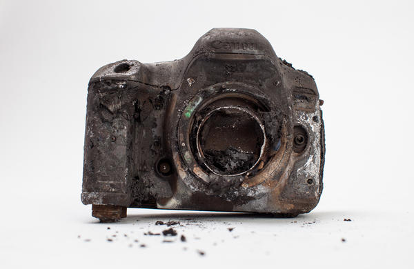 One of Gilkey's cameras, heavily damaged from the attack.